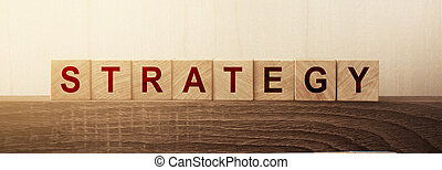Strategy Word on Wooden building Cubes. Business management concept