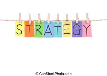 Strategy, words hang by wooden peg - Strategy, paper words...