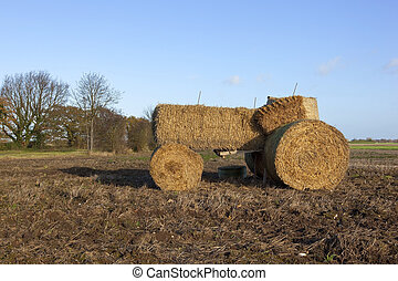 straw bale tractor - autumn landscape with a tractor made...