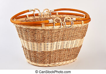 Straw basket isolated on white.