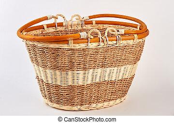 Straw basket isolated on white.