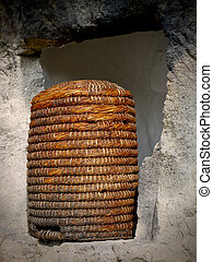 Straw beehive - Straw bee hive in stone window