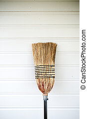 straw broom on a white background