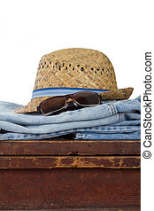 straw hat and vintage sunglasses