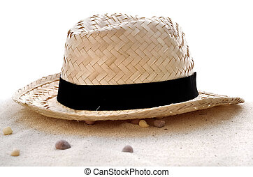 straw hat in the sand
