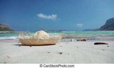 straw hat on sandy beach, holidays concept