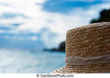 straw hat on the beach