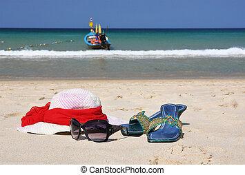 Straw hat on the beach of Phuket island, Thailand