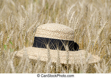 Straw hat on the wheat field
