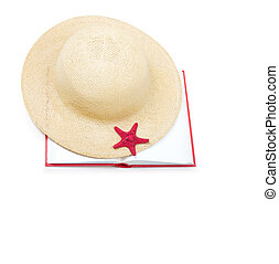Straw hat with book and red starfish isolated on white backgroun