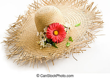 straw hat with floral decoration over white background