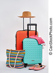 Straw hat, woman accessories, suitcases.