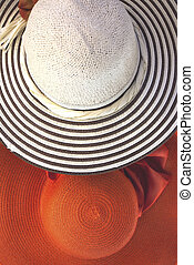 Straw hats as summer concept