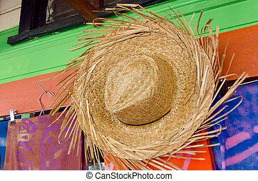 Straw hats for sale in a tropical souvenir shop in Aitutaki...