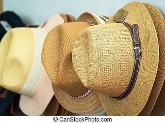 Straw hats for sale in the market.