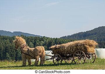Straw horse stuffed with straw wagon