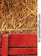 Straw in a wooden box.