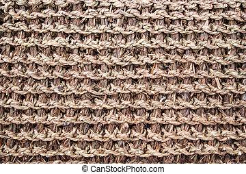 A straw door mat.