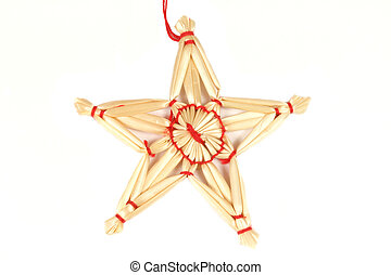 Christmas straw star - rustical ornament isolated on white