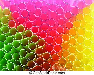 Straw - Background with close-up of multi colored drinking...