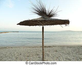 Straw Sunshade at the Beach