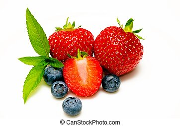 Strawberries and blueberries isolated on white background