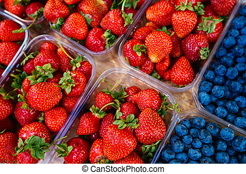 Strawberries and blueberries on the counter