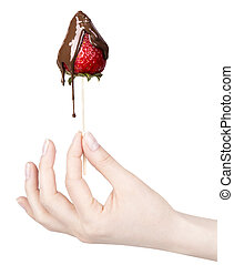 strawberries and chocolate with hand