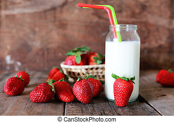 strawberries and milk in a glass