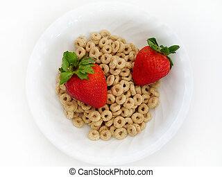 Strawberries and Os - Two juicy strawberries in a bowl of...