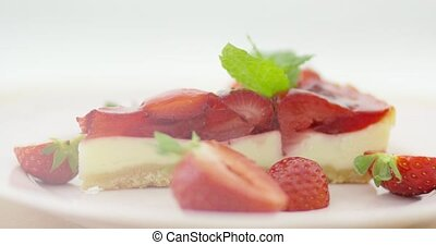 Strawberries and slice of cake - Close-up view of fresh...