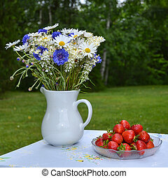Strawberries and summer flowers