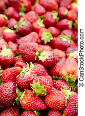 strawberries background fruits focus on foreground market...