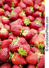 strawberries background fruits focus on foreground market...