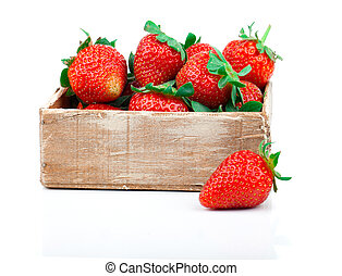 Strawberries berry in the wooden box, isolated on white...
