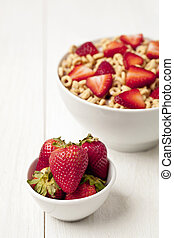strawberries bowl and breakfast cereal