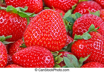 strawberries. Close up with green leaves