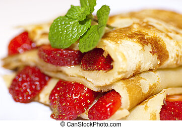 Delicious strawberries crepe on plate.