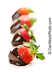 Strawberries dipped in chocolate - Row of strawberries ...