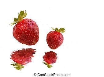 Strawberries falling in water