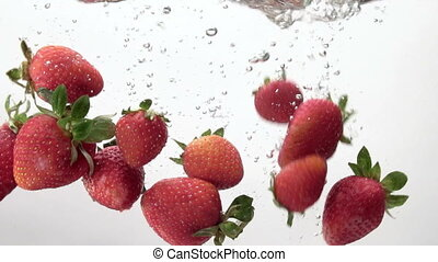 strawberries falling into the water white