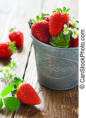 Strawberries in a bucket on the table