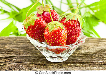 Strawberries in a glass vase