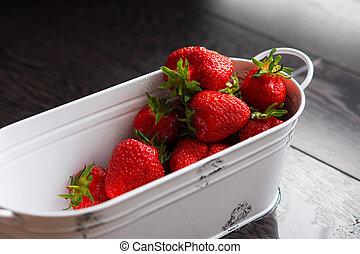 Strawberries in a metal bucket. Top view of sweet strawberries.