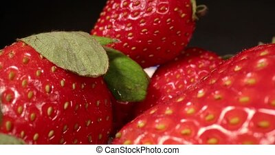 Fresh strawberries in a pile wide angle macro sliding shot