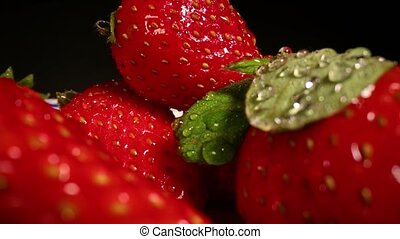 Strawberries in a pile wide angle macro sliding shot