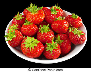 Strawberries in a white bowl isolated over black.