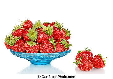 Strawberries in blue glass plate isolated on white background