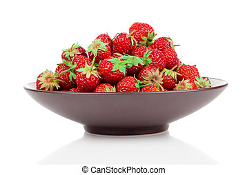 Strawberries in bowl, isolated on white background