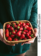 Strawberries in female hands